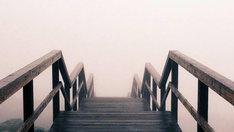 Stairs disappear into fog